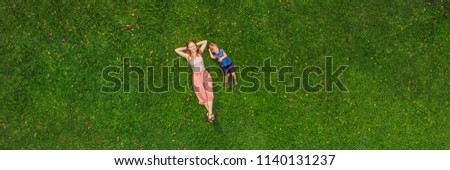 Mom and son are lying on the grass in the park, photos from the drone, quadracopter Stock photo © galitskaya