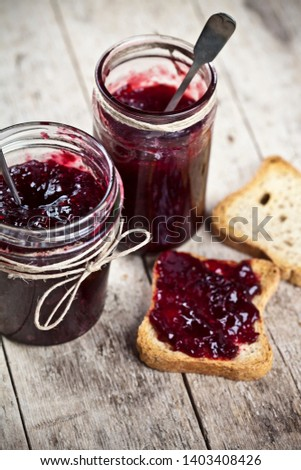Toasted cereal bread slices and jars with homemade wild berries  Stock photo © marylooo