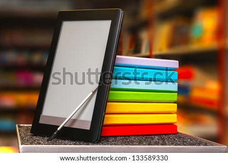 Stack of colorful books and electronic book reader in the book shop Stock photo © AndreyKr