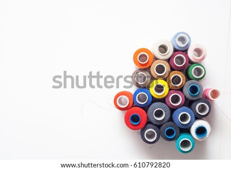 Colorful sewing threads and red scissor isolated on white backgr Stock photo © tetkoren