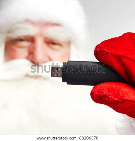 Traditional Santa Claus holding 3g usb modem in his arm on foreg stock photo © HASLOO