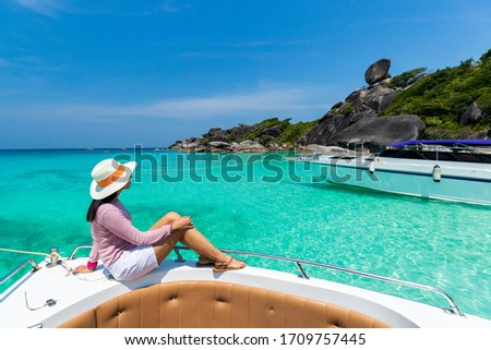 Young woman sitting on a sand of the tropical beach. Very shallo Stock photo © moses