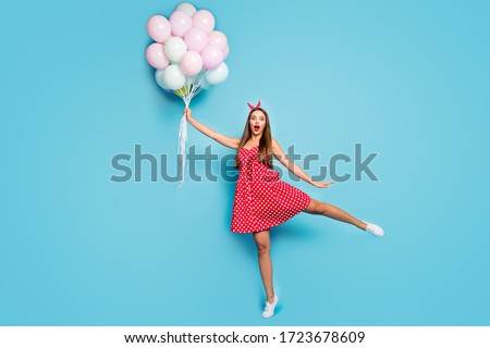 Emotions. Comic Funny Girl with Colorful Air Balloons Grimacing Stock photo © gromovataya
