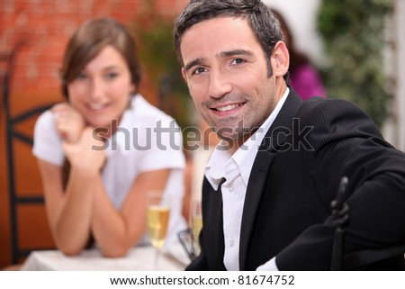 a 40 years old man and a 16 years old girl with sparkling wine on a restaurant table Stock photo © photography33