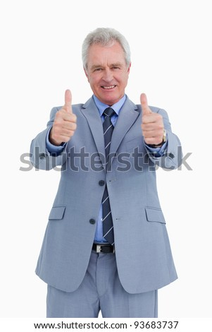 Smiling mature tradesman giving thumbs up against a white background Stock photo © wavebreak_media
