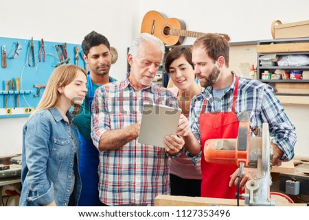 A senior construction worker and his apprentice using a laptop. Stock photo © photography33