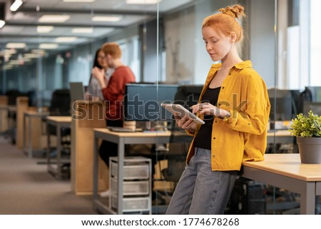 adult pretty business woman making presentation of new product stock photo © hasloo