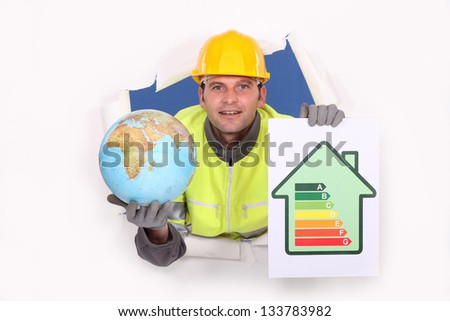 tradesman holding a globe and an energy efficiency rating chart stock photo © photography33