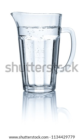 A Glass and а Carafe Full of Water on the Background of Foliage Stock photo © maxpro