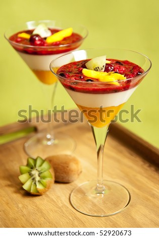 Panna cotta with kiwi, mango and forrest fruit in a martini glas Stock photo © deymos