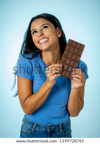 Guilty Looking Young Woman Eating Big Bar Of Chocolate In Studio Stock photo © monkey_business