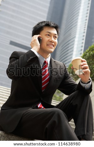 Chinese Businessman Talking On Mobile Phone With Takeaway Coffee Stock photo © monkey_business