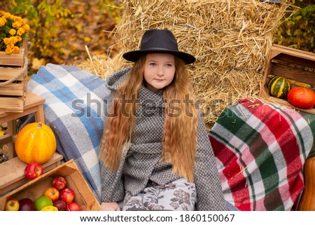beautiful girl with autumn leaves near the apple tree and blue f stock photo © nejron