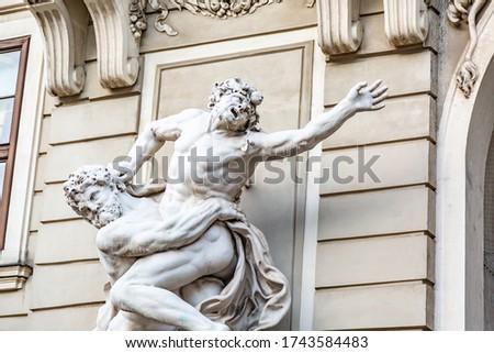 Statue of Hercules fighting Antaeus at Hofburg palace entrance Stock photo © pixachi