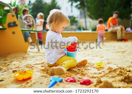 toddler playing with sand Stock photo © zdenkam