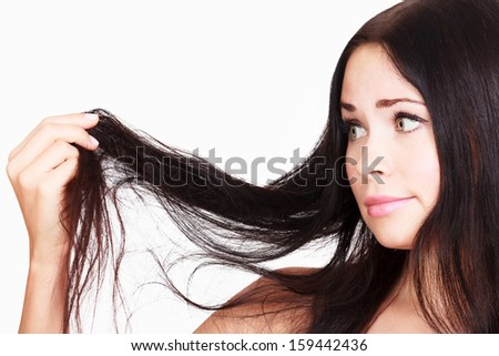 woman is not happy with her fragile hair, white background, copy Stock photo © Nobilior