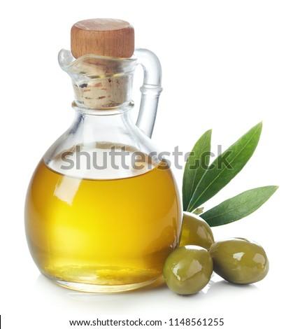 филиала оливками бутылку оливкового масла изолированный белый Сток-фото © tetkoren