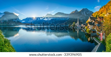 reflection of mountain village in hallstatter see austria euro stock photo © meinzahn