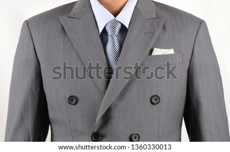 businessman in double breasted suit standing with hands in pock Stock photo © feedough