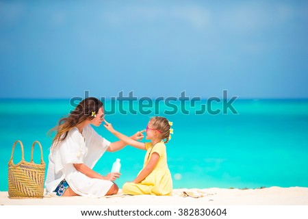 Mother and daughter on the beach. Sun protection infographics ve Stock photo © maia3000