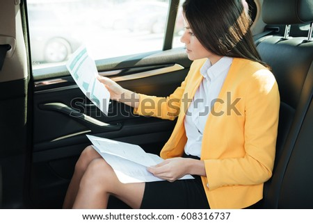 Side view of a concentrated businesss woman analyzing documents Stock photo © deandrobot