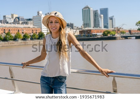 Pensive young woman leaning on a rail of a bridge Stock photo © Giulio_Fornasar