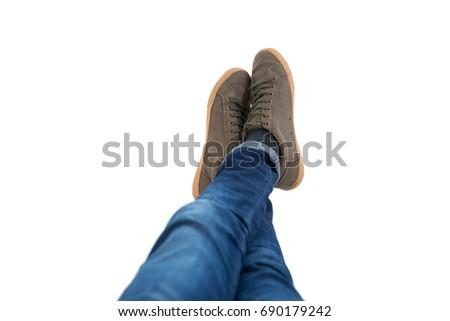 Teenage boy lying with legs crossed at ankle on white background Stock photo © wavebreak_media