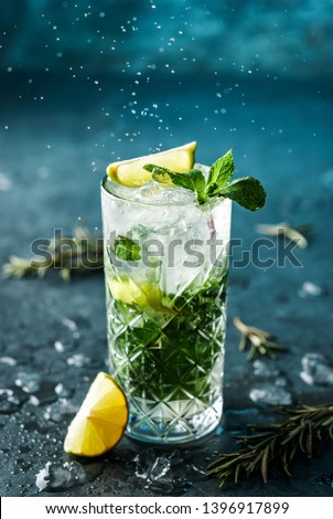 Lemon mojito cocktail with lime, mint and raspberry, cold drink with ice. Stock photo © yelenayemchuk