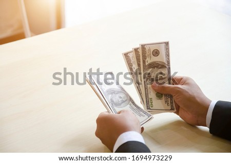 Bank employees are counting banknotes received or paid to custom Stock photo © snowing