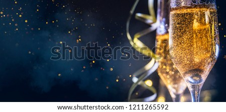 New Year Eve celebration background two glasses champagne. Abstract sparkling light magic glitter Stock photo © Iaroslava