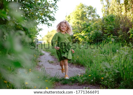 young pretty blond girl with curly blond hair and little flowers happy smiling on blue sky backgroun stock photo © iordani