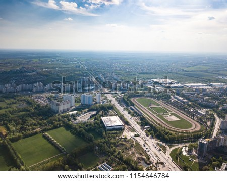 Panoramic photo of the city of Kiev with the stadium Olympic against the blue sky. Stock photo © artjazz