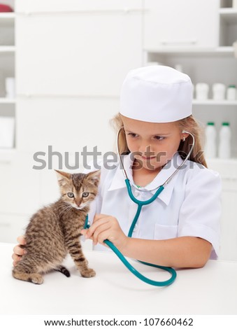little girl checking her kitten with a stethoscope at the veteri stock photo © ilona75