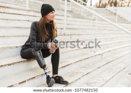 Portrait of athletic handicapped woman with prosthesis in tracks Stock photo © deandrobot
