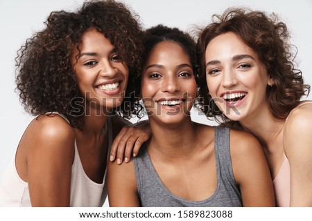 Image of three beautiful smiling women of different nation: cauc Stock photo © deandrobot