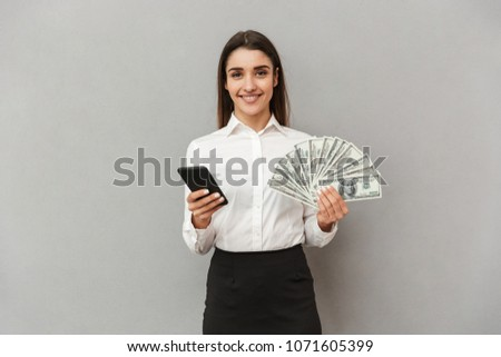 Portrait of rich office woman with long brown hair in business w Stock photo © deandrobot