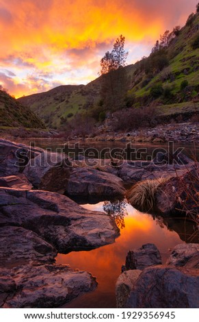 Sunrise skies and brilliant colour over rockpool Stock photo © lovleah