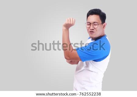mutlu · genç · Asya · adam · poz · yalıtılmış - stok fotoğraf © deandrobot