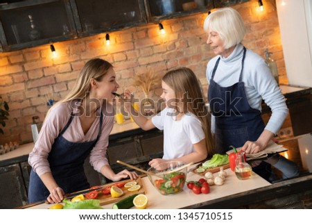 Beautiful little girls with they mother in the kitchen preparing Stock photo © dashapetrenko