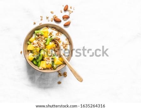 tropische · vruchten · ontbijt · eigengemaakt · yoghurt · gezonde - stockfoto © illia