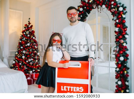 Two cute little children sending a letter to Santa Claus. Smilin stock photo © IvanDubovik