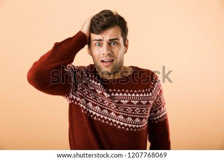 Obraz człowiek 20s ściernisko trykotowy Zdjęcia stock © deandrobot
