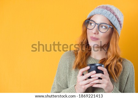 Image of joyful woman 20s wearing casual clothing drinking cockt Stock photo © deandrobot