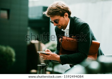 relaxed businessman wearing leather jacket standing with hand in Stock photo © feedough