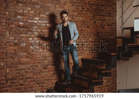 portrait of attractive gentleman posing while looking down to si Stock photo © feedough