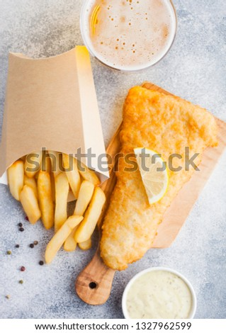 traditional british fish and chips with tartar sauce abd glass of craft lager beer and tomato ketchu stock photo © denismart