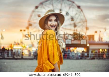 Woman enjoying in funfair and riding on colorful carousel house Stock photo © galitskaya