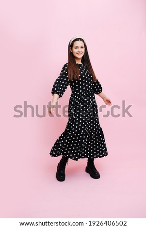 portrait of brunette woman wearing polka dots dress having wine stock photo © dashapetrenko