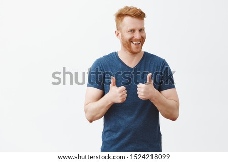 heerful handsome man smiling showing thumb up like gesture choosing five stars rating stock photo © ichiosea