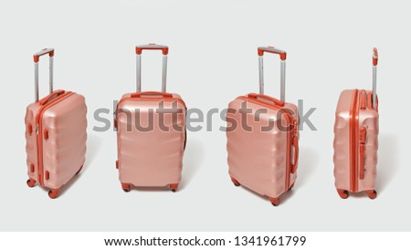 four modern brown suitcases on a gray background with copy space for text the concept of travel and stock photo © artjazz